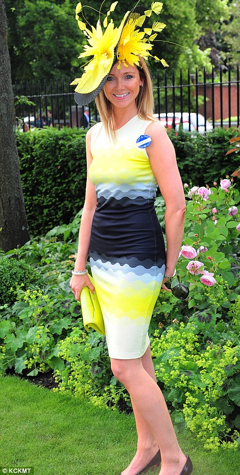 a lady in a yellow and blue ensemble on day 4 of Royal Ascot 2014
