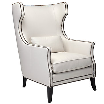 White leather wing back chair nailhead trim