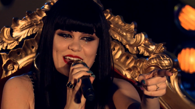 Jessie J, singing Domino pointing from a throne, London 2011.