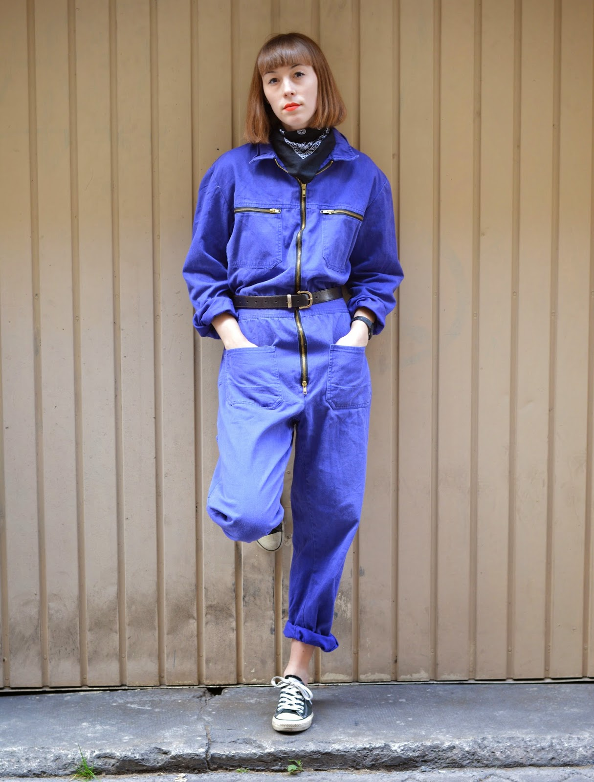 Blue work jumpsuit with bandana and converse