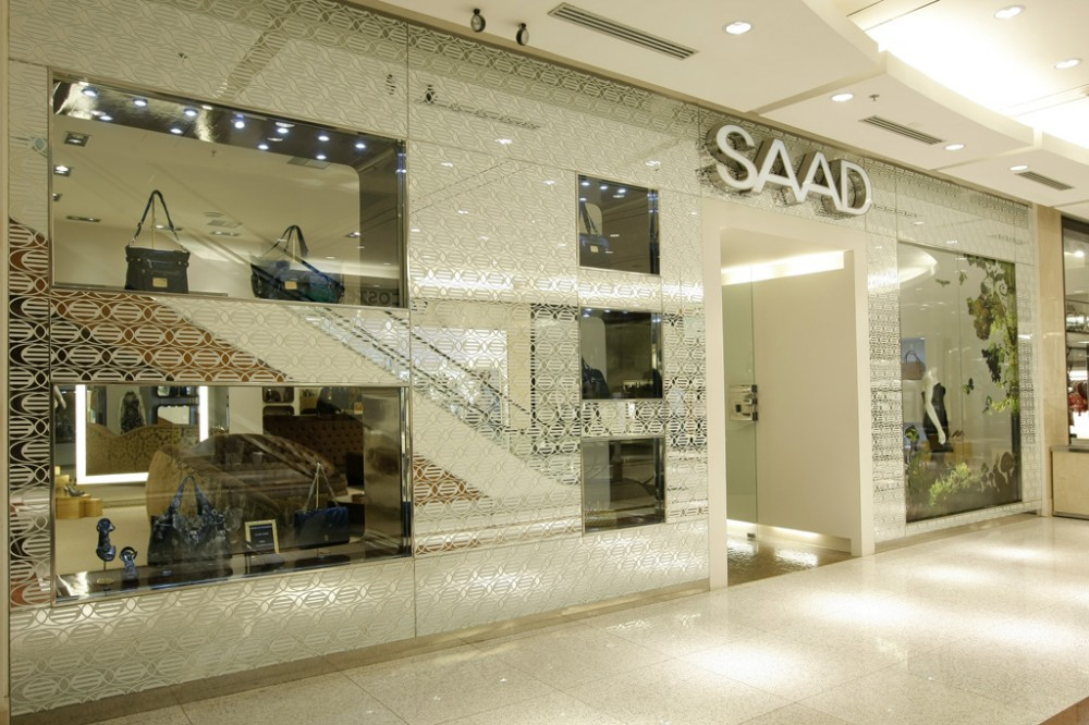 Mititique boutique saad fashion boutique minimalist for Boutique interior design