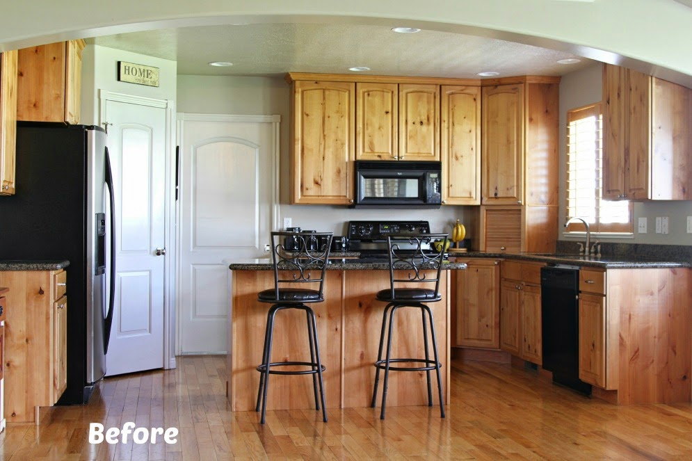 White painted kitchen cabinet reveal with before and after for Kitchen cabinets before and after