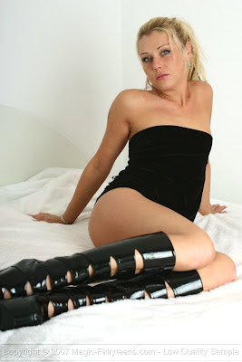 Sexy Blonde on Bed in Shiny Boots