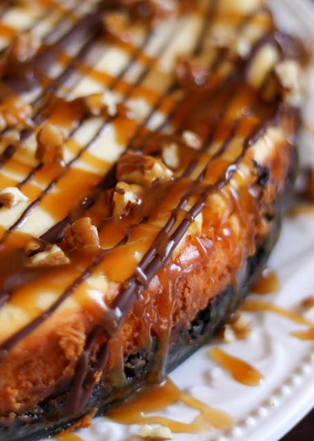 Turtle Cheesecake with caramel, chocolate, pecans, and an Oreo crust! - get the recipe at barefeetinthekitchen.com