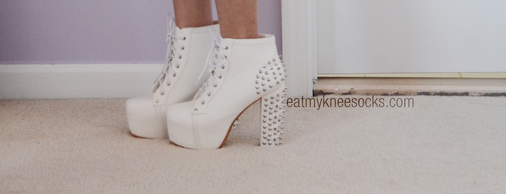 Milanoo's affordable white spiked high-heel platform booties are great for making you seem taller.