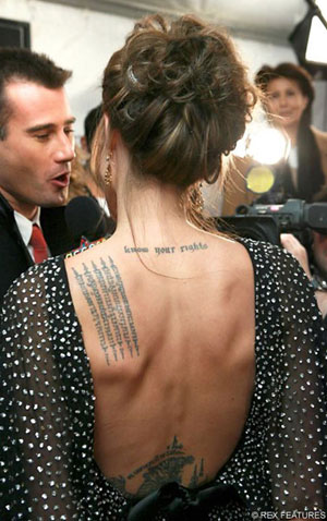 Angelina Jolie recently voted the sexiest woman has many tattoos and is