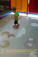 3 year old boy plays a game using an eye-click floor