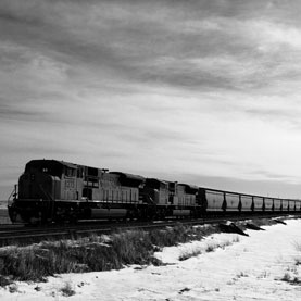 A coal train crosses the northern plains near Lethbridge, Alberta. U.S. exports of coal are at an all-time high and could rise higher as domestic utilities switch to natural gas. Experts say the country is simply shipping pollution associated with coal overseas. Image: Flickr/urbanworkbench