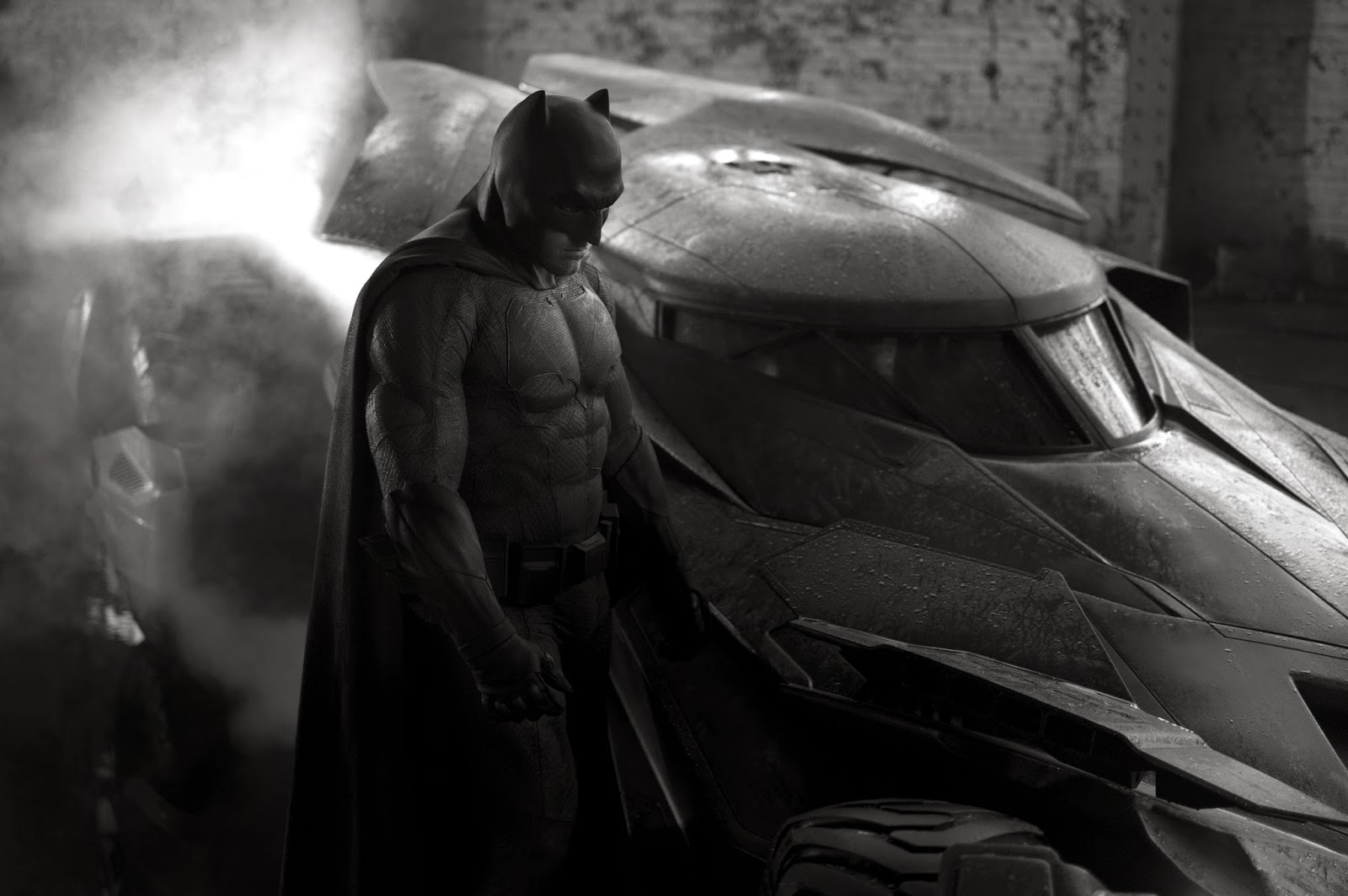 "Ben Affleck as Batman.  The batsuit is heavily influenced by ""The Dark Knight Returns,"" with short stubby ears on the cowl and an oversized bat on his chest."