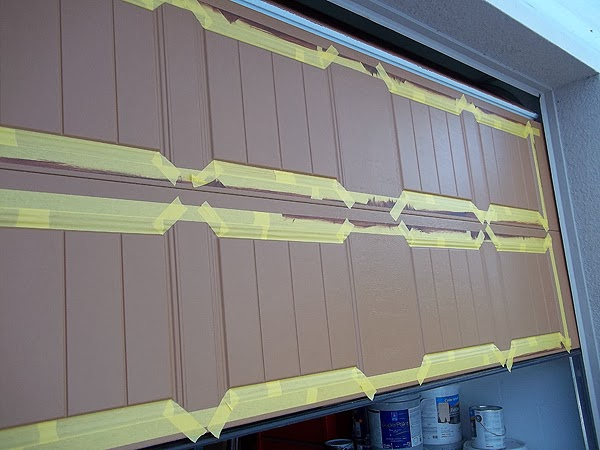 putting tape on a garage door to be painted to look like wood