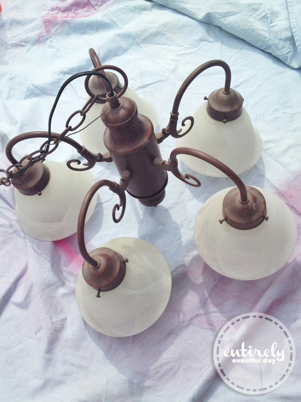 DIY Chandelier from an ugly light fixture. This is so fabulous! entirelyeventfulday.com #chandelier #lights #DIY