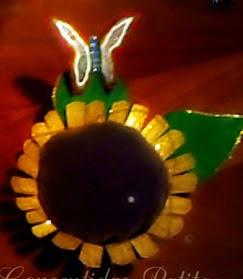 http://tu-yo-el-ella-todos.blogspot.com.es/2014/01/alfiletero-o-acerico-reciclado-flor.html