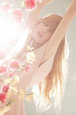 woman waking up in the morning, fresh flowers, fragrance ad campaign
