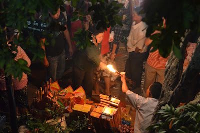 Incense vendor, Lunar New Year at Wat Phnom, Phnom Penh, Cambodia