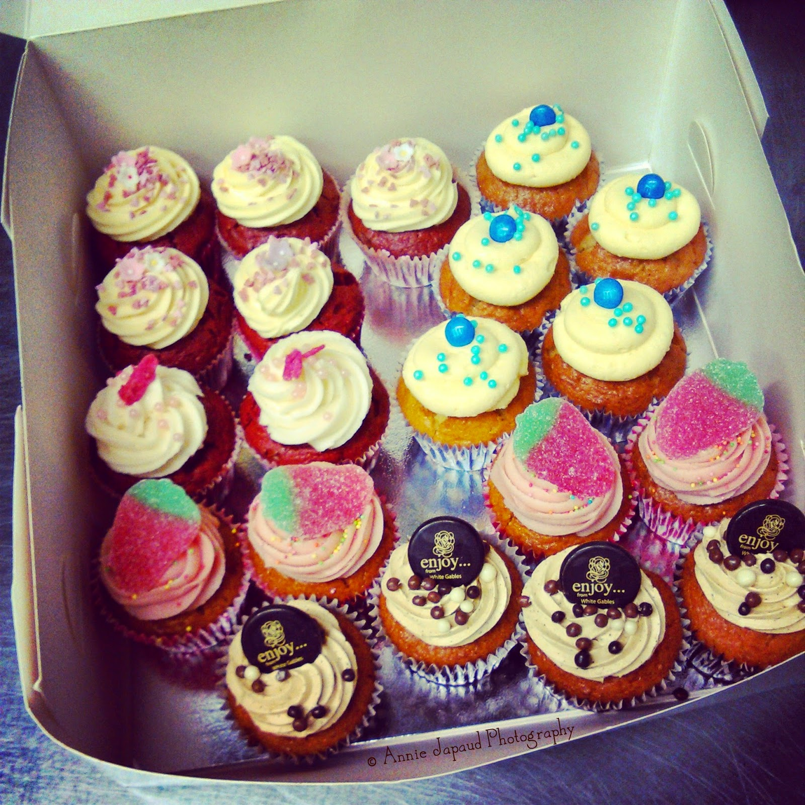 a box full of cupcakes