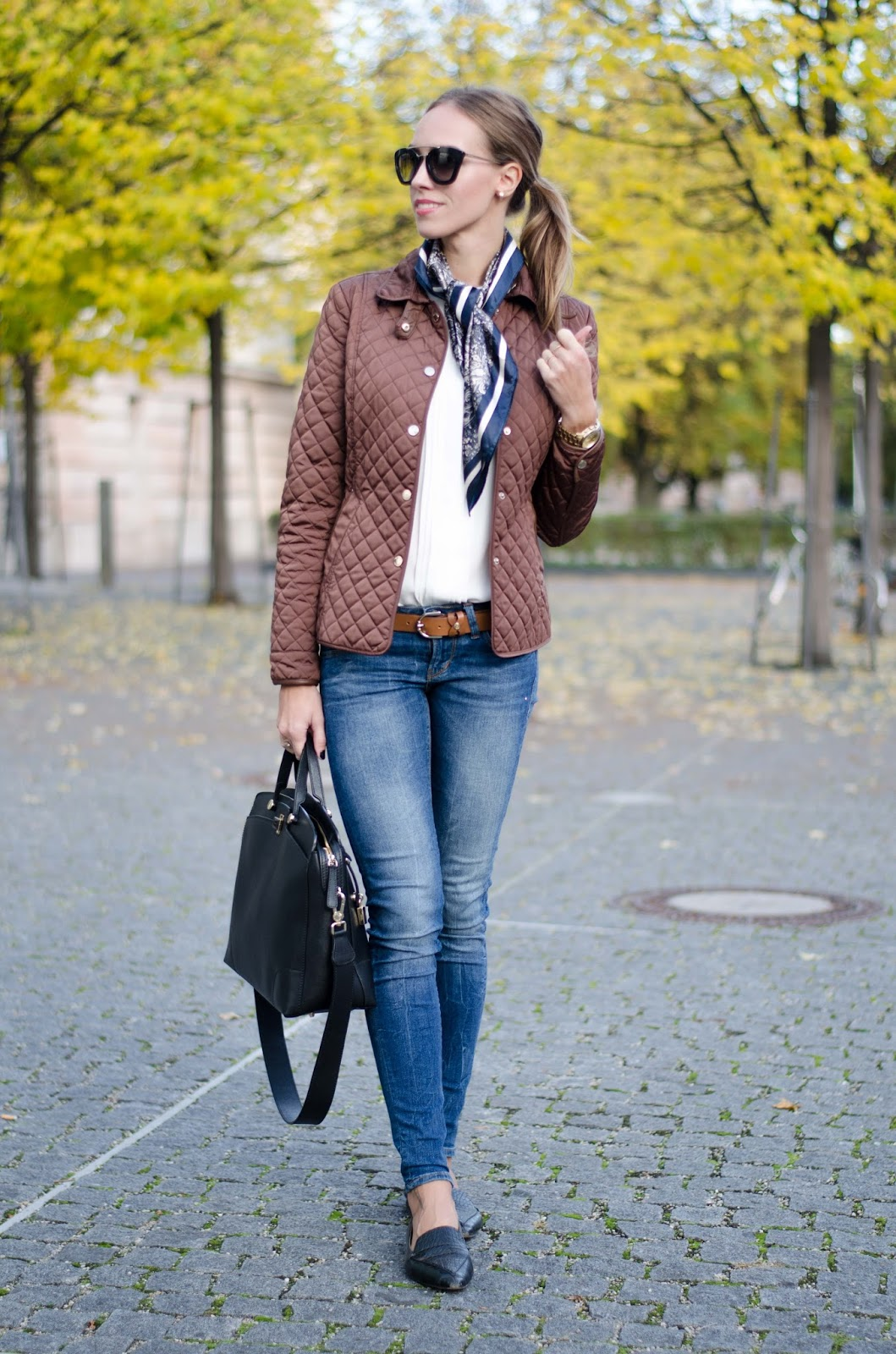 kristjaana mere classy fall outfit quilted jacket blue skinny jeans flats