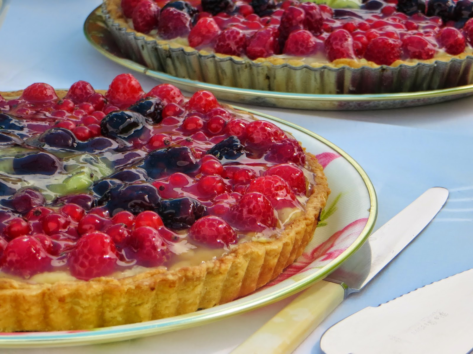 Lovely homemade tarts with homegrown fruit.