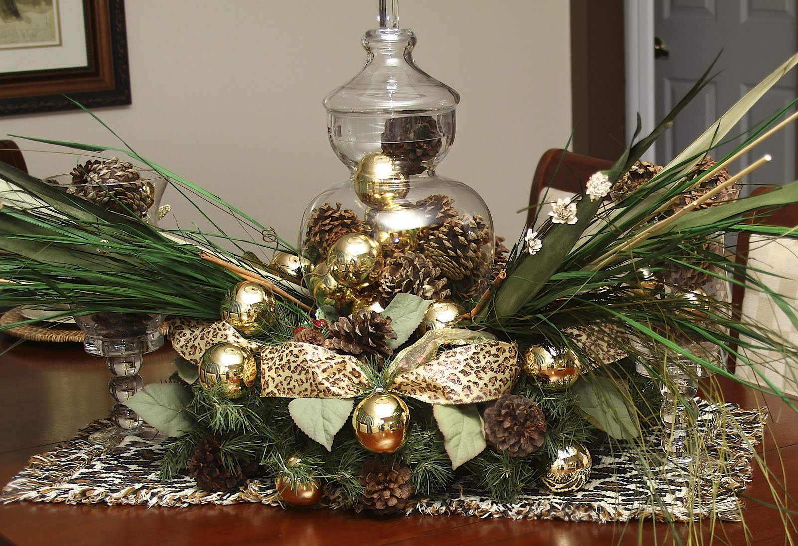 I Started With A Basic Christmas Wreath And Laid It On A Table Runner (leopard  Print, Of Course) I Then, Added An Apothercary Jar (filled With Pine Cones