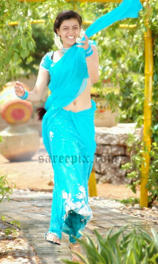 Kajal-agarwal-jumping-half-saree-Chandamama-movie