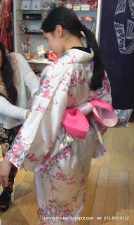Putting a casual kimono on girl