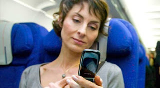 Virgin Atlantic Airways is first British airline to allow in-flight mobile phones use.