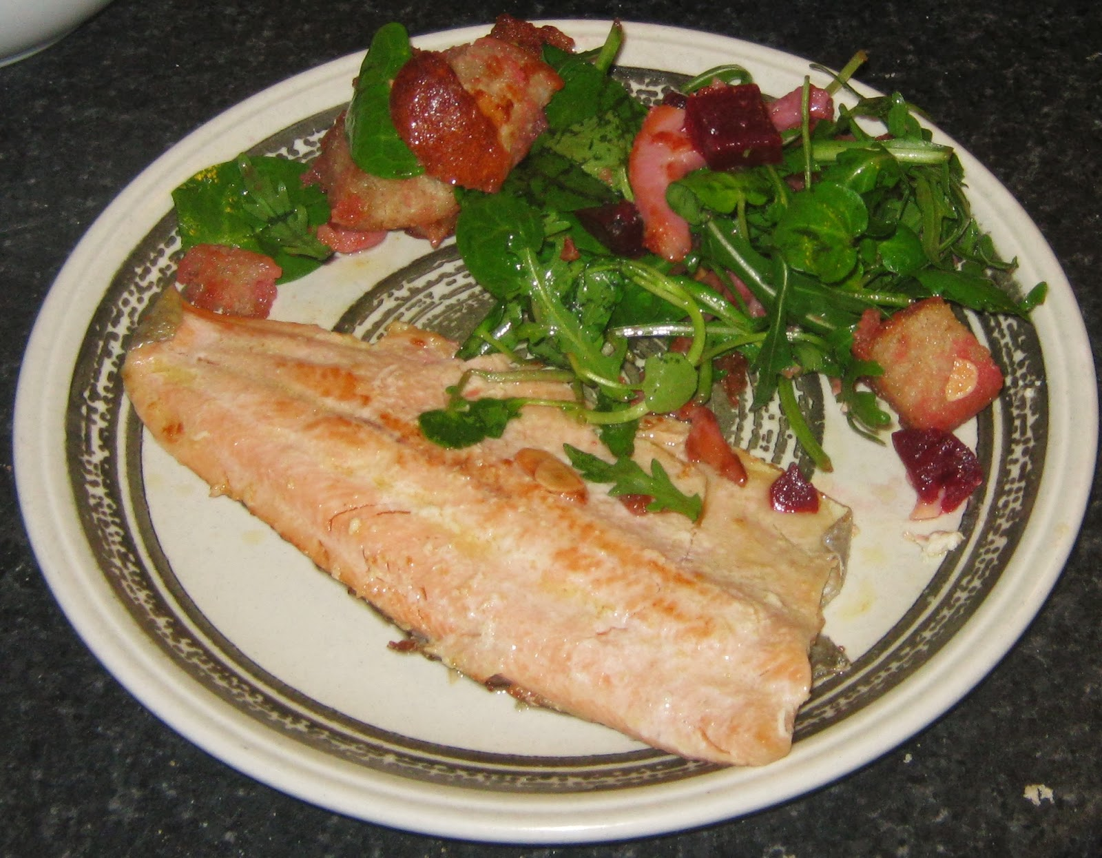 Pan-fried trout with mixed salad, bacon, almonds and beetroot