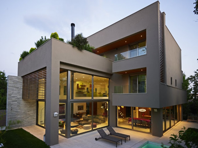 Modern home with concrete and glass facade