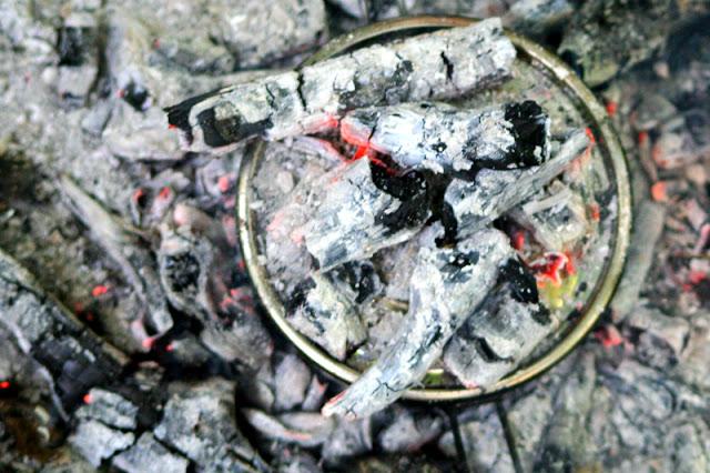 hot coals on the pot lid