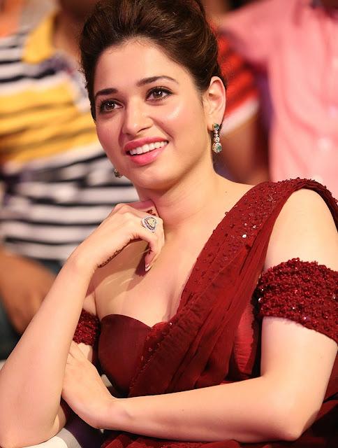 Tamannaah Bhatia Super Sexy Skin Show In Maroon Dress At 'Baahubali' Audio Release Event
