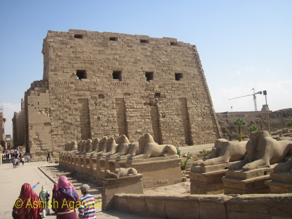 View of a row of Sphinx statues at the entrance to the Karnak temple