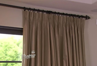 Make your room seem taller by placing curtain rod near ceiling