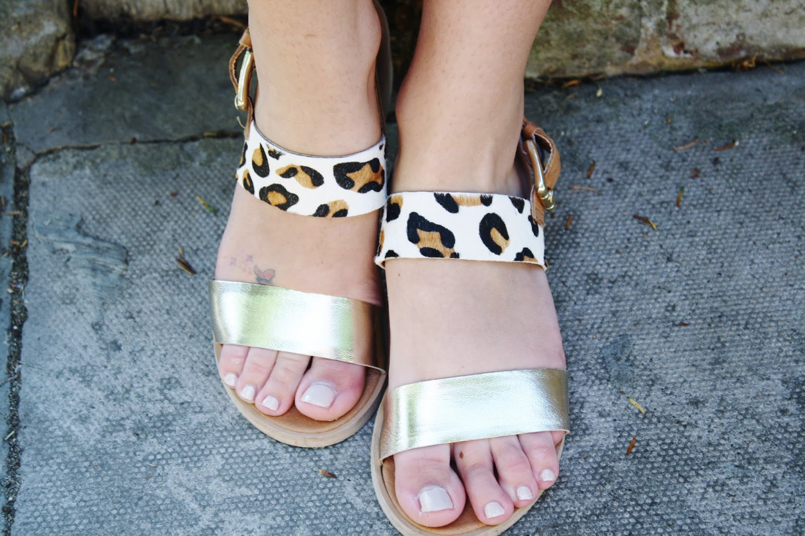 close up shot of leopard print and metallic sandals from Ravel
