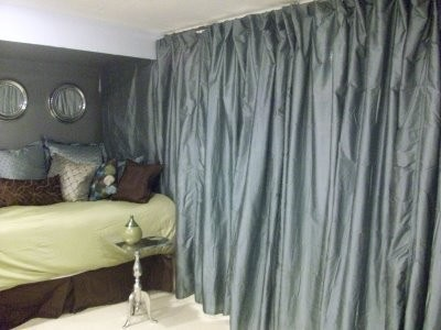 You may want to incorporate a room ider by hanging beads a curtain