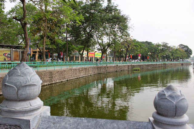 Crossing the bridge to Tran Quoc Pagoda in Hanoi, Vietnam