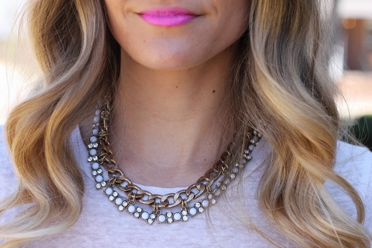 Blonde Ombre hair Color with Statement necklace and Hot Pink Lipstick