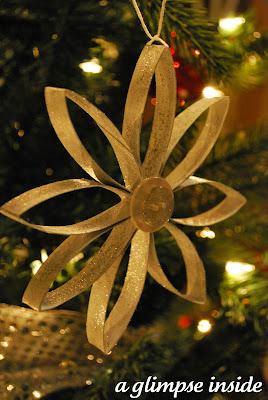 http://www.aglimpseinsideblog.com/2011/12/cardboard-snowflake-ornament.html