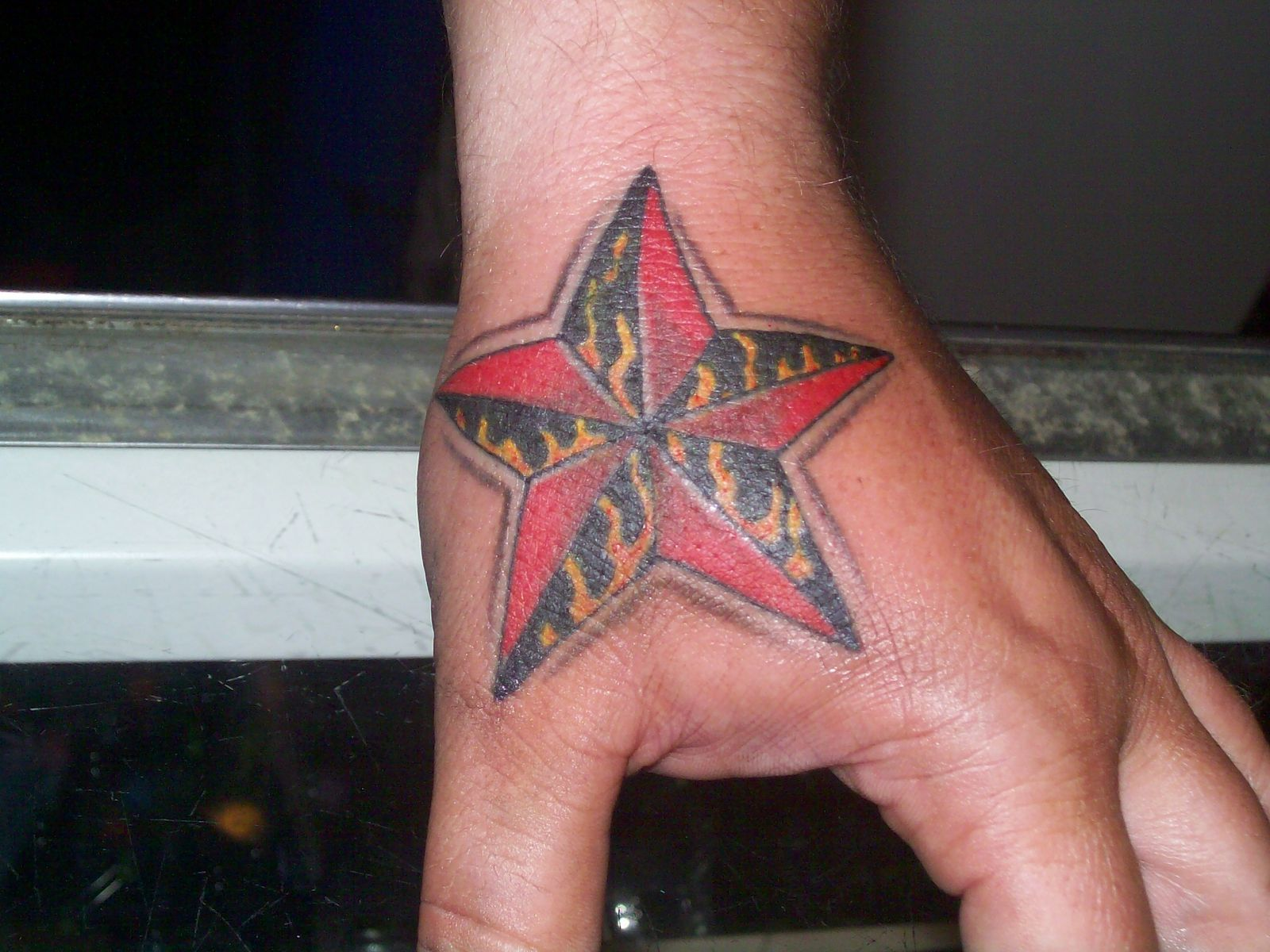 Star tattoos star tattoos for guys star tattoos men for Mens star tattoo