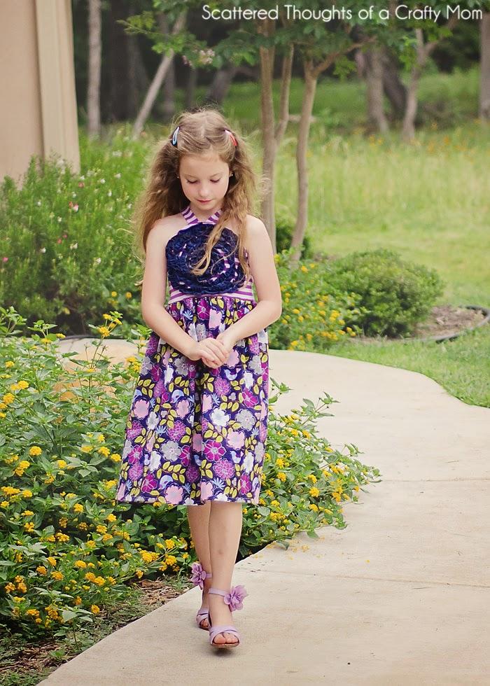 http://www.scatteredthoughtsofacraftymom.com/2014/06/ruffled-flower-sundress-free-pattern.html