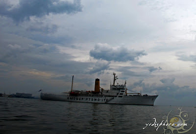 Photo of T/S KFO calmly floating in Manila Bay