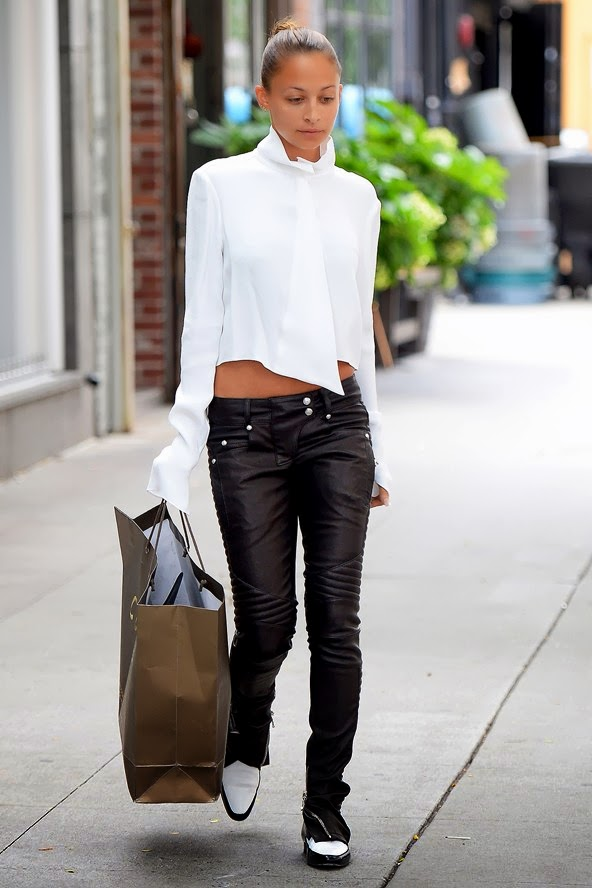 nichole richie in a crop shirt,leather pants and androgynous shoes