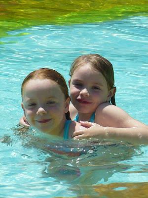 sisters in pool