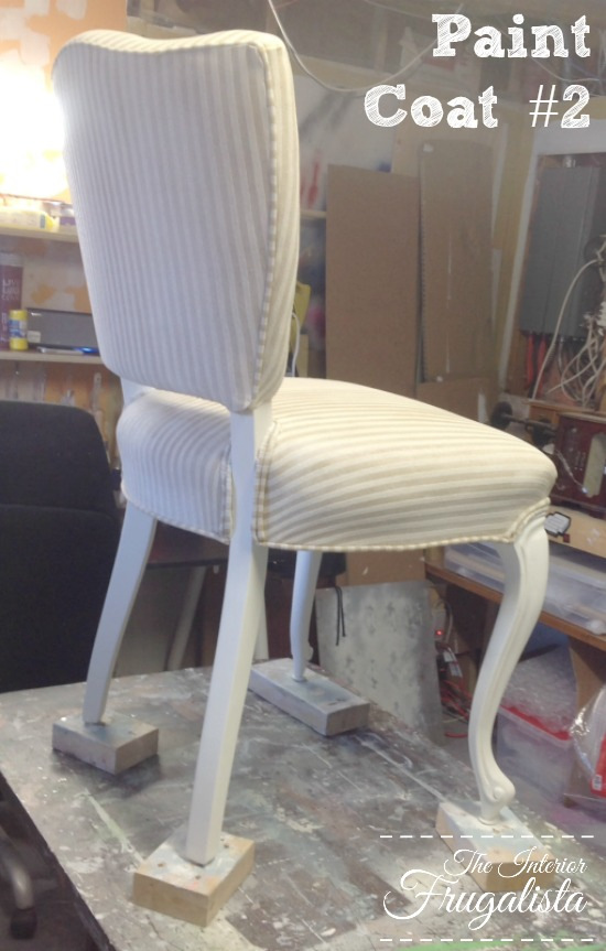 Chalk painting a French Provincial chair white after Second Coat