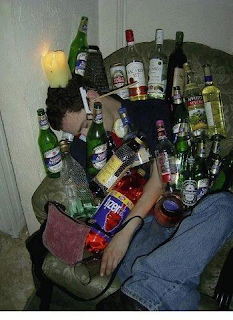 funny picture: drunken fool sleeps with bottles of alcohol