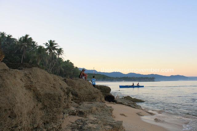 fishermen waiting along the shore