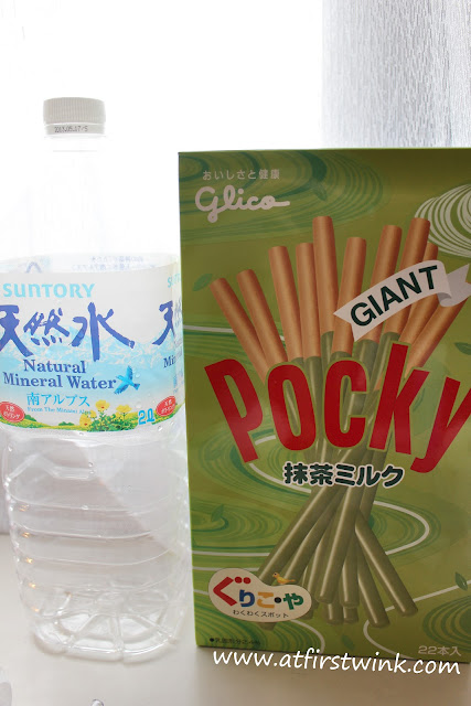 Box of Pocky Giant green tea flavor next to a 2 litre bottle of mineral water