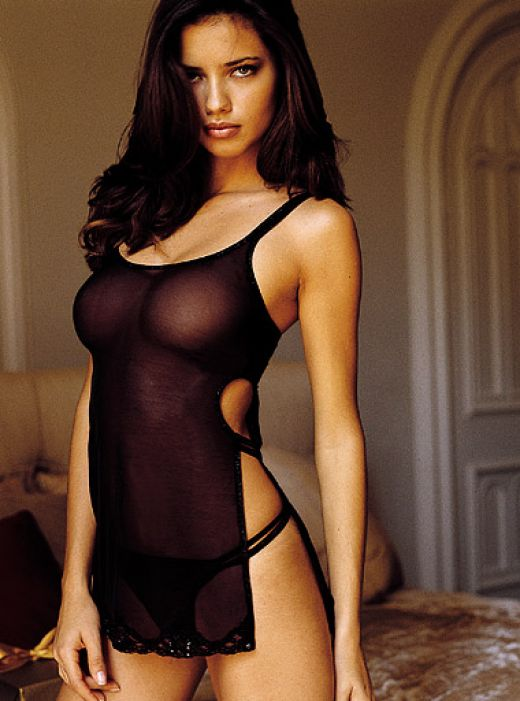 Adriana Lima exposing boobs in black