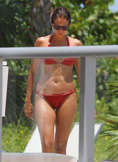 Olga Kurylenko wearing red bikini with her head down