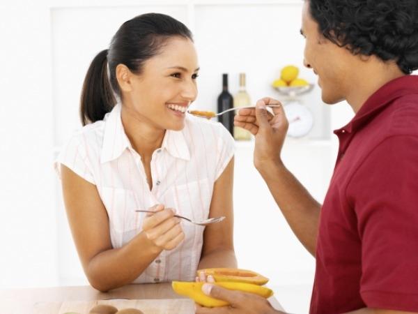Couple eating papaya