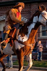 man dressed in pioneer clothes riding a horse as part of a reenactment of the Pony Express