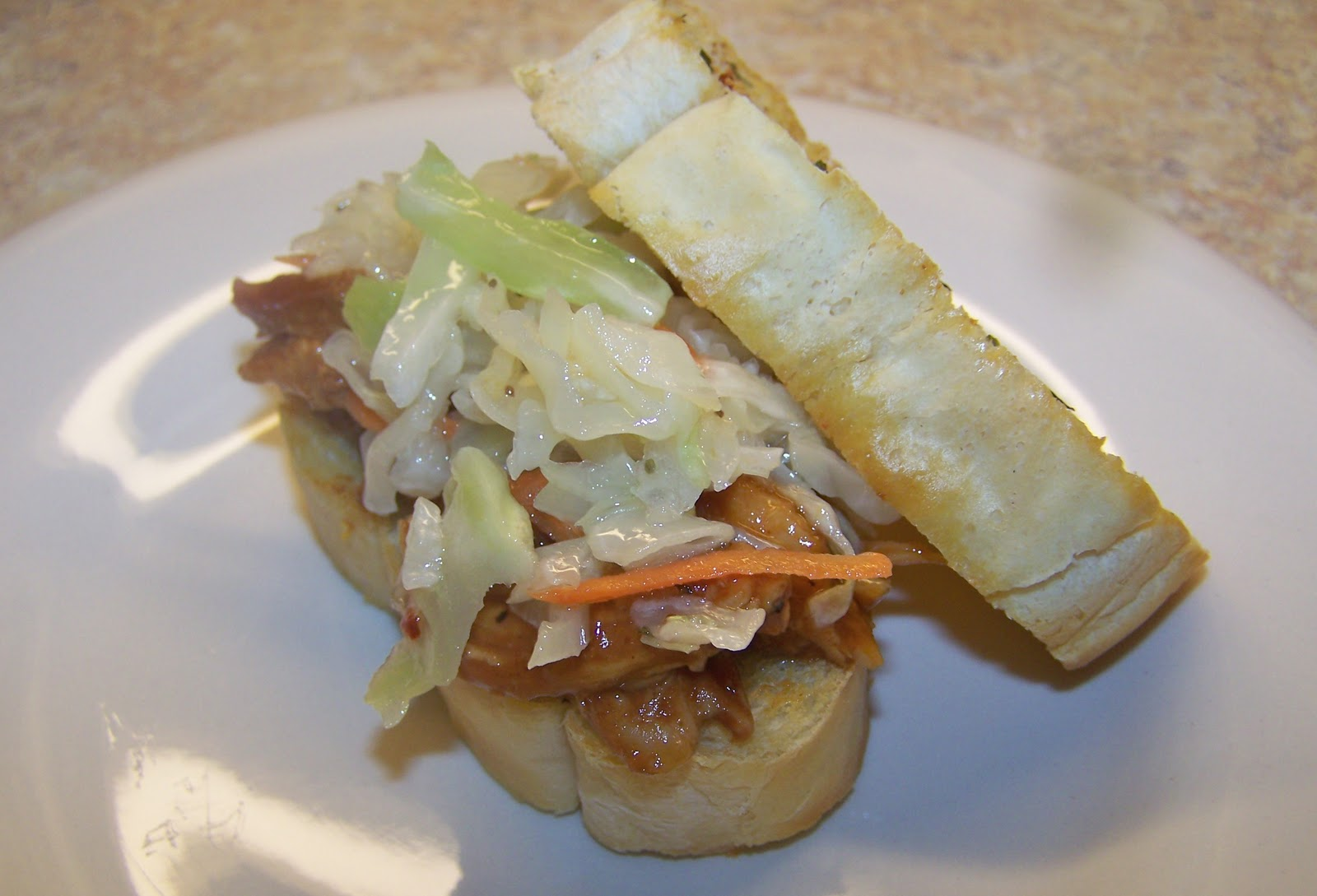 ... Treat: Shredded BBQ Chicken and Southern Slaw on Buttery Garlic Toast